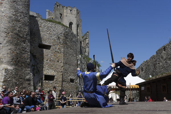Historical reenactment of a traditional duel at the Beckov Castle, illustrative stock photo.
