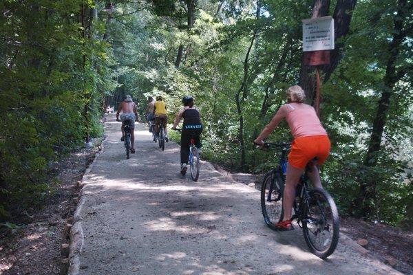 Tourist cycling, illustrative stock photo