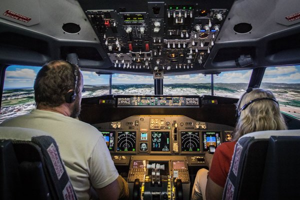 The simulator is an exact copy of Boeing 737's cockpit interior, including the control wheels, knobs, switches, buttons and monitors.