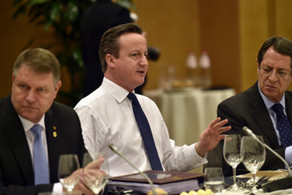 British PM David Cameron (C) at the EU summit February 19.