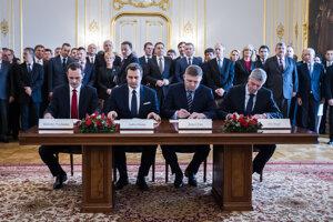 Radoslav Procházka, Andrej Danko, Robert Fico and Béla Bugár sign the coalition agreement in March 2016.
