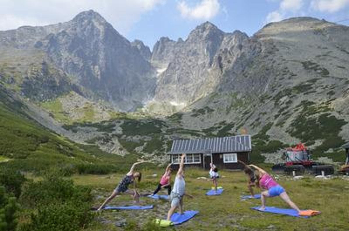 Tourists do Yoga exercises at Skalnaté Pleso in High ...