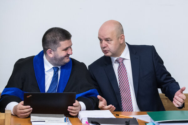 Pavol Rusko (r) and his lawyer Michal Mandzák during the September 20 trial.