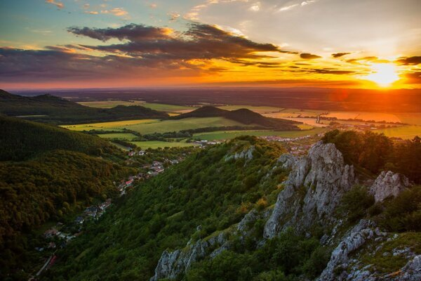 The sun sets in a village underneath the Kršlenica hill