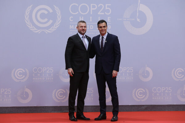 "Spain's Prime Minister Pedro Sanchez and Slovakia's Prime Minister Peter Pellegrini shake hands at the COP25 climate talks summit in Madrid, Monday Dec. 2, 2019. The chair of a two-week climate summit attended by nearly 200 countries warned at its opening Monday that those refusing to adjust to the planet's rising temperatures ""will be on the wrong side of history."""