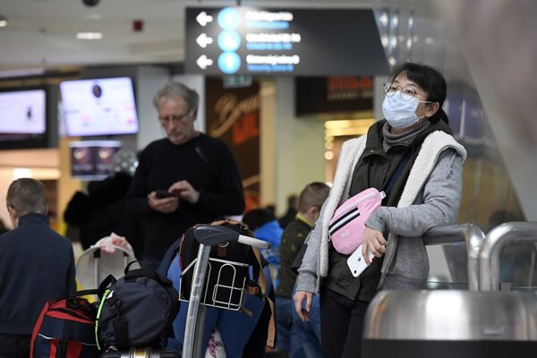 A passenger wears a face mask at Ferenc Liszt International Airport in Budapest, Hungary, on February 4, 2020.