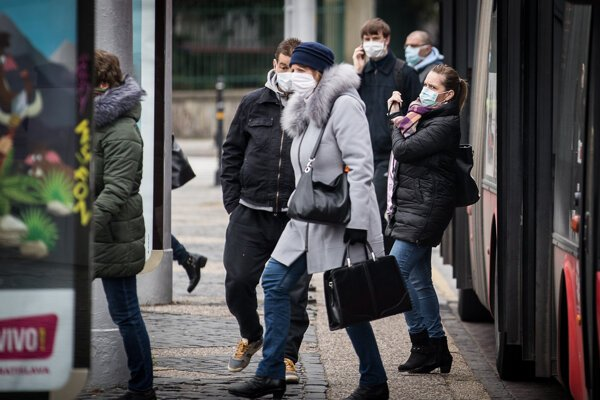 People in protective masks on public transport in Bratislava.