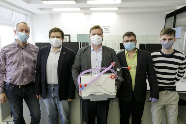 Young Slovak scientists brothers Samuel Furka (in the middle) and Daniel Furka (second left), senior doctor Patrik Palacka (second right),  Michal Géci, coordinator of the humanitarian project (left) and student Dalibor Gallik (right).