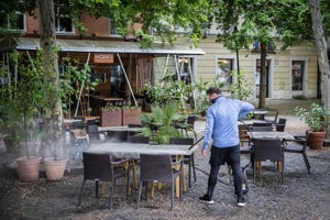 A restaurant worker in Bratislava prepares outdoor seating for when restaurants reopen on May 6 in Slovakia.