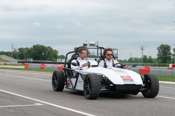 Transport Minister Andrej Doležal (l) during a test ride of the autonomous vehicle developed by STU and technology companies.