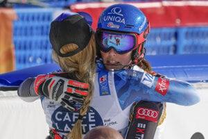 Bronze medallist United States' Mikaela Shiffrin, left, hugs silver medallist Slovakia's Petra Vlhová, in the finish area of the women's slalom, at the alpine ski World Championships in Cortina d'Ampezzo, Italy, Saturday, Feb. 20, 2021.