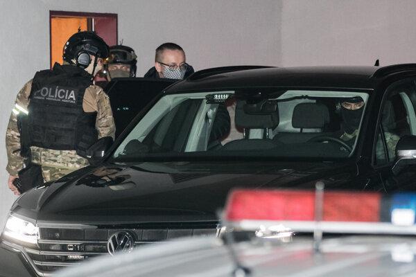 Vladimír Pčolinský being taken into custody.