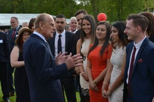 Prince Philip and young people who took part in the Duke of Edinburgh's Award talk at Buckingham Palace in 2012.