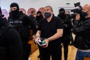 Dušan Kováčik escorted to the courtroom.