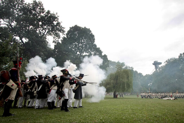 """The """"soldiers"""" fired antique rifles, wowing spectators and scaring some children."""