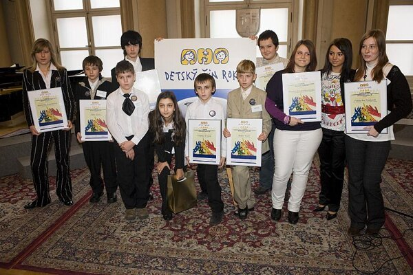 Children who received a Noble Deed award pose after the ceremony.