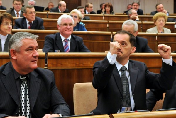 Ján Slota and Rafael Rafaj  react as their law is passed.