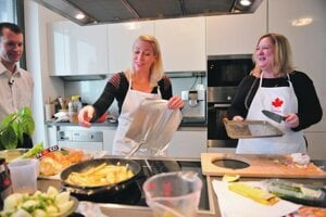 Kathy Bunka and Isabelle Savard prepare to cook up a storm, in a 2012 series Cooking with Ambassadors.