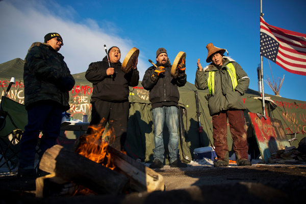 Native Americans drum and sing at the Oceti Sakowin camp where people have gathered to protest the Dakota Access oil pipeline in Cannon Ball on December 4, 2016.