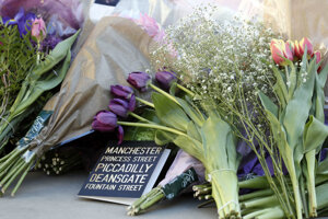 Floral tributes are laid out in Manchester, England, on May 23, 2017, the day after the suicide attack at an Ariana Grande concert that left 22 people dead as it ended on May 22 night.