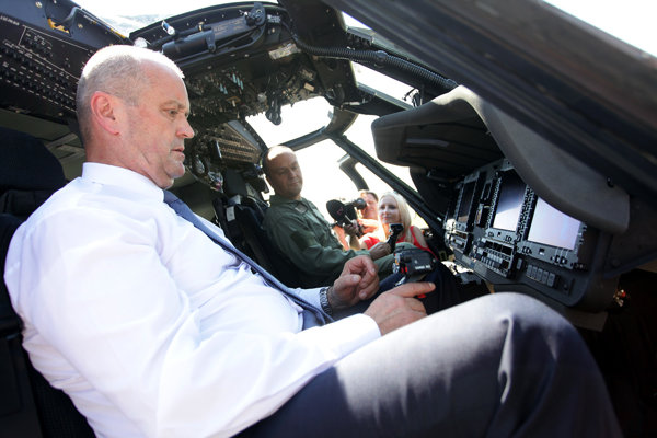 Defence Minister Peter Gajdoš in a Black Hawk helicopter.