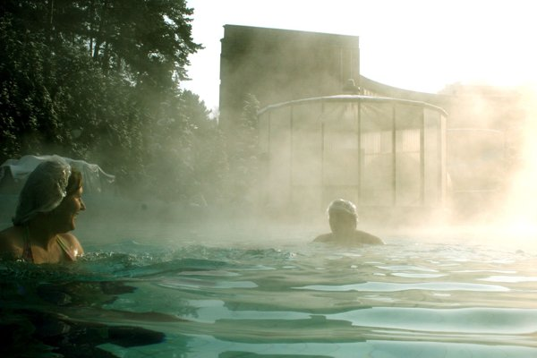 People enjoying hot water in Bojnice spa.