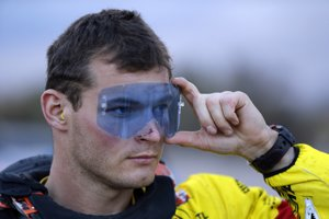 Slovakia's Stefan Svitko, with the KTM Slovnaft Team, tests sunglass before the start of the tenth stage of the Dakar Rally between Belen and La ioja, Argentina Wednesday, Jan. 13, 2016.
