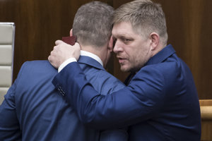 Former PM Robert Fico congratulates Prime Minister Peter Pellegrini for winning support for his cabinet in parliament.
