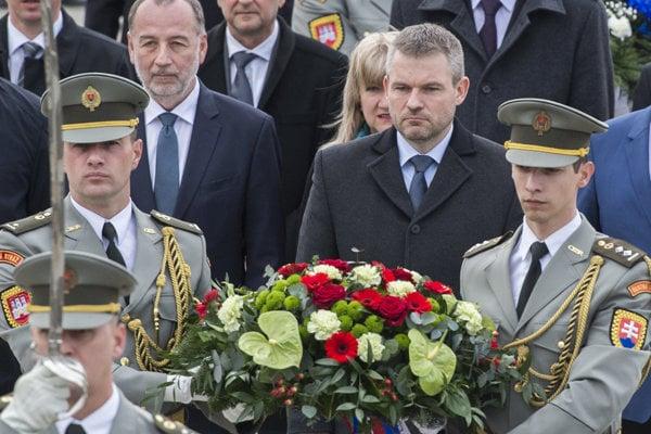 PM Peter Pellegrini (C) laying wreaths at the Slavín WWII memorial in Bratislava.