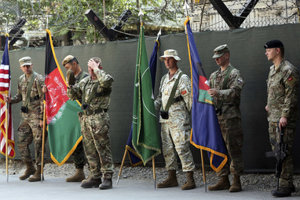 Afghanistan and NATO soldiers hold their flags before the start of the change of command ceremony at Resolute Support headquarters, in Kabul, Afghanistan, Sunday, September 2, 2018