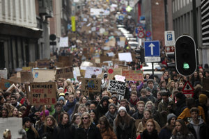 Thousands of youngsters crowd the streets as they march during a climate change protest in Brussels, Jan 31, 2019.