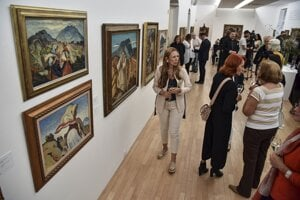 People attend the Martin Benka exhibition at the SOGA auction company in Bratislava on September 10, 2019