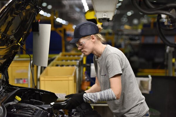 An employee works on a car model at the PSA Groupe Slovakia car plant in Trnava, western Slovakia, on April 4, 2019.