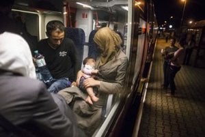 Refugees on a train in Hungary.