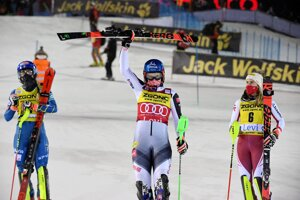 Petra Vlhová of Slovakia (centre), flanked by second placed Mikaela Shiffrin of the United States (l) and third placed Katharina Liensberger of Austria, celebrates after winning the alpine ski, women's World Cup slalom in Levi, Finland.