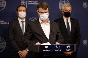 Cabinet members Marek Krajčí (l), Štefan Holý (centre) and Ivan Korčok (r) announce new restrictions for Christmastime during the December 16 press conference.