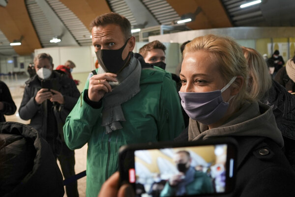 Alexei Navalny and his wife Yuliastand in line at the passport control after arriving at Sheremetyevo airport, outside Moscow, on Sunday, January 17, 2021.
