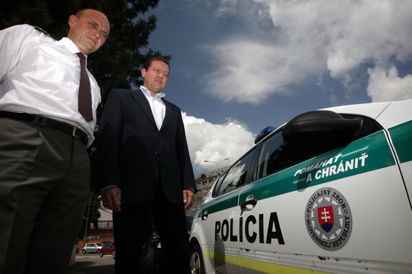 """June 2011. Police Corps President Jaroslav Spišiak and Interior Minister Daniel Lipšic present new logo """"Help and protect"""" that will be located at police vehicles."""