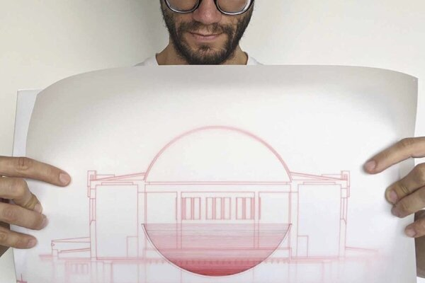 Juraj Gábor with a drawing of the 'Sphéra' project.
