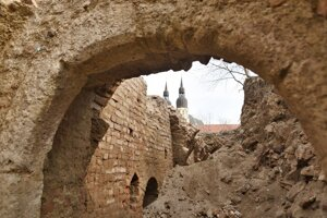 WEEK 12: The remains of a gothic cellar were found near a Trnava synagogue on March 19, 2021. In the background, the Basilica of St Nicholas stands.