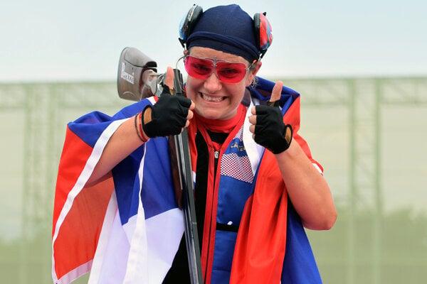 Zuzana Rehák Štefečeková celebrates her victory in the women's trap at the 2020 Summer Olympics in Tokyo.