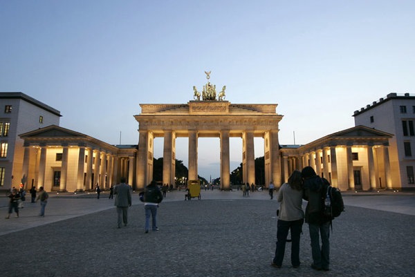 German foundations are helping the development of civil society in over 70 countries. The Brandenburg Gate in Berlin is a symbol of linking the East with the West.