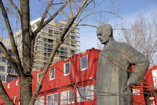 Celebrated Slovak architect Dušan Jurkovič looks on as another new building rises up next to him.