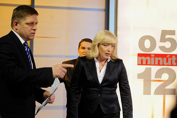 Fico and Radičová before the start of their TV duel.