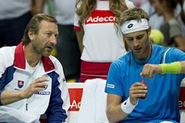 Captain Miloslav Mečíř (R) briefs tennist Norbert Gombos at the Davis Cup duel with Poland.