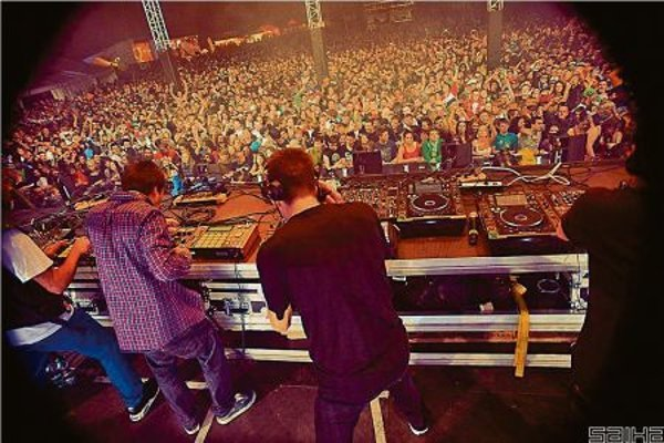 DJs at a Let it Roll event get the audience pumping.