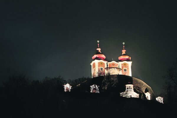 The calvary in Banská Štiavnica is being renovated and isnowlit up at night.
