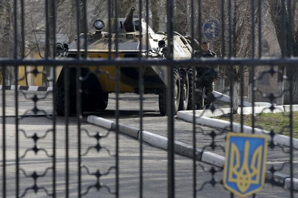 A Ukrainian armored personnel carrier is stationed behind the gate of a military base in the port of Kerch, Ukraine, on March 3, 2014.