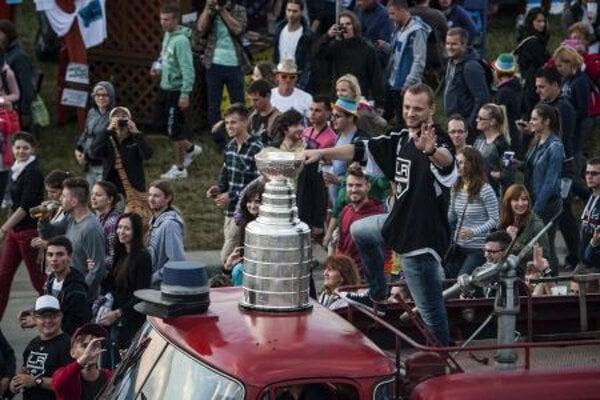 Hockey player Marián Gáborík riding around the festival with the Stanley Cup.