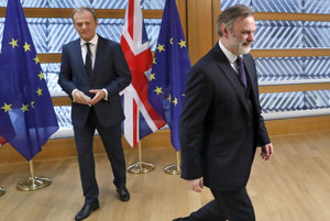 Britain's permanent representative to the European Union Tim Barrow (right) leaves after he delivered the Brexit letter to EU Council President Donald Tusk in Brussels.